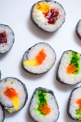 Abstract and conceptual of sushi plate. Sushi is a set of typical dishes of Japanese cuisine with rice along with ingredients such as fish, seaweed, vegetables or eggs. The filling is raw or cooked.
