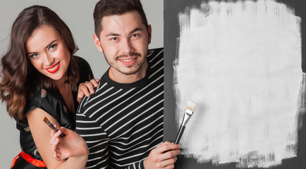 Couple with paint brushes