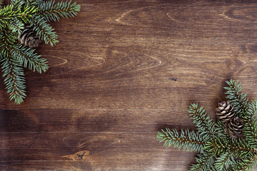 New Year's background. Spruce branches on a wooden table. Ornaments for the New Year tree. Christmas concept.