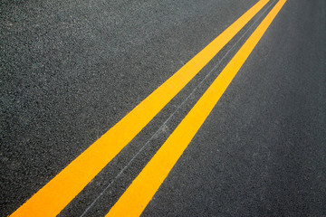 Double yellow lines on the asphalt road