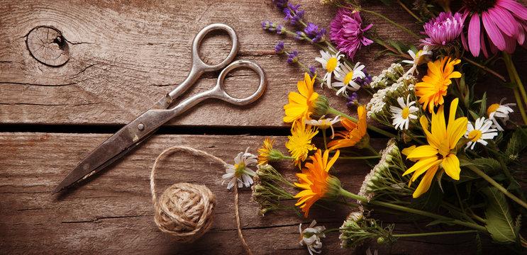 Bouquet of wild flowers scissors vintage board