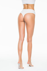 Rear view of beautiful caucasian woman with long legs, isolated on white background
