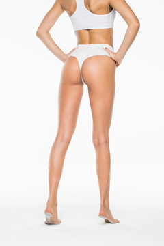 Back view of a perfect long woman waxing legs and butt isolated on white background