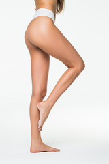 Side view of perfect female legs and buttocks. Heathcare concept.