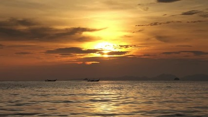 Wall Mural - Long tail boats in the sea at sunset, Thailand, 4k