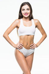 Fitness woman with a beautiful body isolated on white background. healthcare concept.