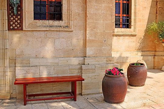 Bench and wine bowls with flowers near the Cana greek orthodox wedding church in Cana of Galilee, Kfar Kana, Israel