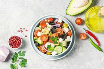 Avocado feta Greek salad in a bowl. Top view, space for text.