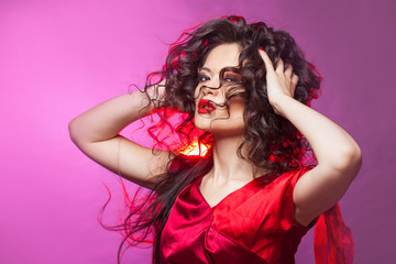 girl with the curls dancing, portrait in Studio with bright toning,