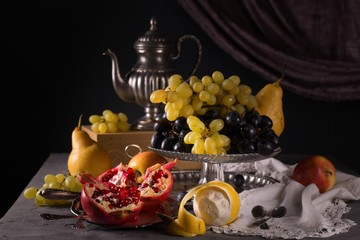 Still life with vintage items, fresh ripe fruit