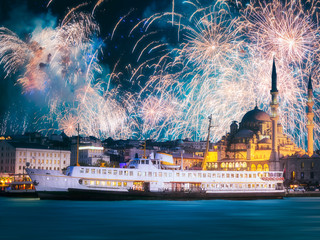 Beautiful fireworks above public ferry and old district of Istanbul