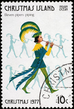 Twelve days of Christmas - 11 pipers piping on postage stamp of Christmas Island