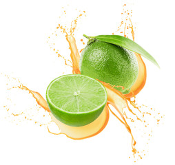 limes in juice splash isolated on a white background