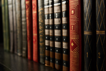 Old books on a bookshelf as abstract background. Vintage books