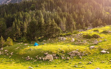 The Camping Tent at the mountain meadow at summer time