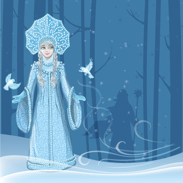 Beautiful young girl snow maiden with two snow birds flying around in the winter forest and the silhouette of Russian Santa Claus behind the trees. Character of Russian folklore.
