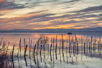 Sunset in the calm waters of the Albufera de Valencia, Spain.Boat ride in the Sunset of the calm waters of the Albufera de Valencia, Spain.