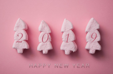 greeting 2019 card with pink marshmallows in shaped fir on pink background