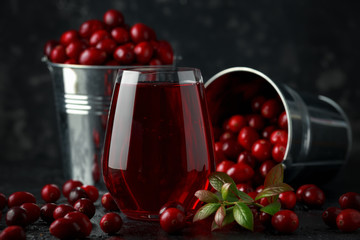 Fresh Cranberries juice in glass. Freshly made, organic, rustic style.