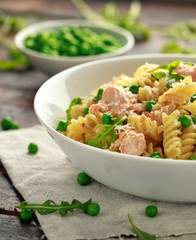 Homemade Pasta fusilli with salmon, green peas, parmesan cheese and lemon. close up. healthy food