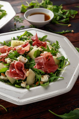 Parma ham and melon salad with mozzarella, rocket and pine nuts