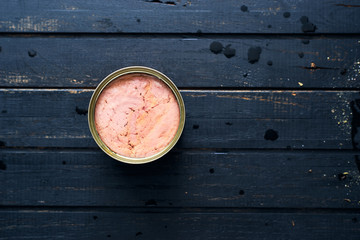 Canned tuna fish with olive oil in a can top view