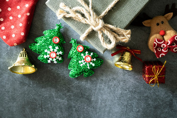 Christmas background with gift box and dear doll . Top view with copy space
