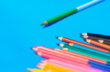 Multicolour pencils isolated on blue background.Close up several colors. Selective focus.