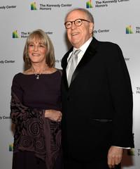 Rita Braver and Robert Barnett arrive for gala dinner at US State Department