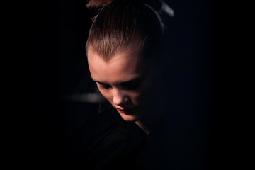 """A model waits backstage before the """"Alexander Wang Collection 2"""" presentation in Brooklyn, New York City"""