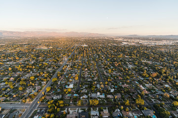 Late afternoon aerial view of San Fernando Valley homes and streets of Los Angeles, California.