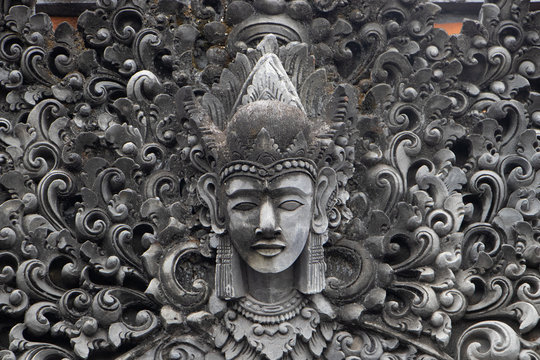 Indonesia god statue in front of bali temple.Traditional indonesian hindu symbol in ubud,Bali,Indonesia