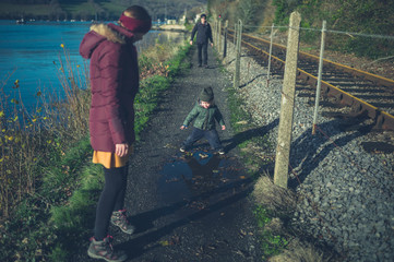 Multi generational family walking by railway tracks