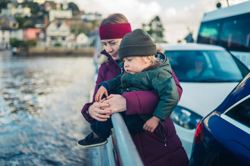 Young woman and toddler on car ferry