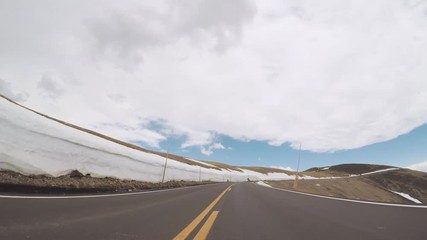 Wall Mural - Driving on Trail Ridge Road on opening weekend of the season in Rocky Mountain National Park.