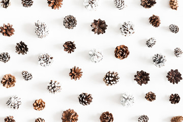 Christmas composition. Pattern made of pine cones on white background. Christmas, winter, new year concept. Flat lay, top view