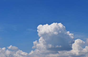 Cumulus cloud on beautiful blue sky , Fluffy clouds formations at tropical zone , Thailand