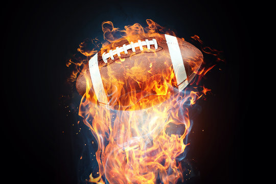 American football game. Soccer ball enveloped by fire. The concept of sport, wrestling, speed, opposition. Mixed media, copy space.