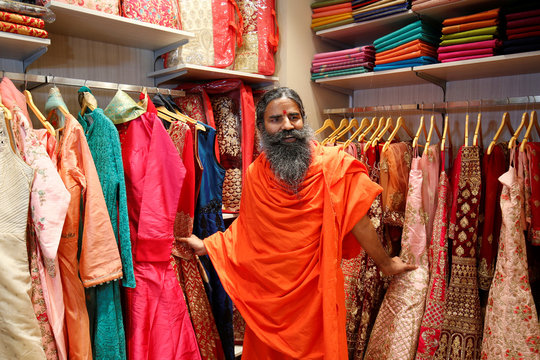 Yoga guru Baba Ramdev poses for a photograph during the opening of Patanjali Paridhan apparel store in Ahmedabad