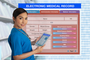 Wall Mural - Female doctor holding tablet with blank electronic medical record form on background.