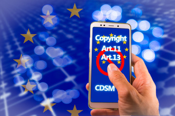 Smartphone with Copyright related words and EU flag on screen. Symbolizing the EU Directive on Copyright in the Digital Single Market or CDSM. Art. 13 is known as meme ban