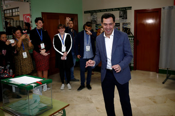 Andalusian regional People's Party (PP) leader and candidate Juan Manuel Moreno Bonilla reacts before casting his vote for the Andalusian regional elections at a polling station in Malaga