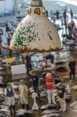 Rusty lamp above traditional japanese fish market in shallow depth of field using bokeh effect