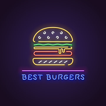 Hamburger neon sign. Glowing neon sign of big burger. best hamburgers letters glowing in retro colors. Fast food restaurant concept.