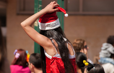 Jewish young girl celebrate the Purim holiday at street event