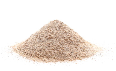 Pile of integral wheat flour isolated on white background