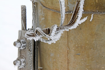 Steel plate and wire in the frost and snow