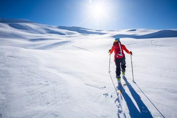 Fototapete -  Ski Touring in mountains.