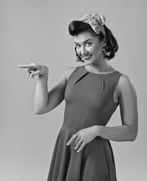 Attractive young woman in 50s style with perfect make-up and hairstyle.