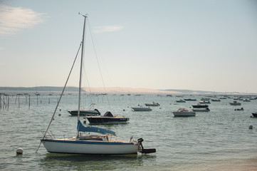 Old boats and yachts are on the bay in the sea